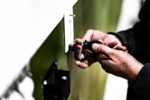 handyman Installing wall plate